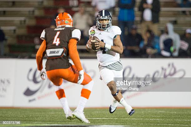 Quarterback Kevin Ellison of the Georgia Southern Eagles looks to maneuver by defensive back Eilar Hardy of the Bowling Green Falcons on December 23...