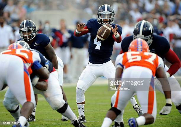Quarterback Kevin Ellison of the Georgia Southern Eagles takes a snap during the second quarter against the Savannah State Tigers on September 6 2014...