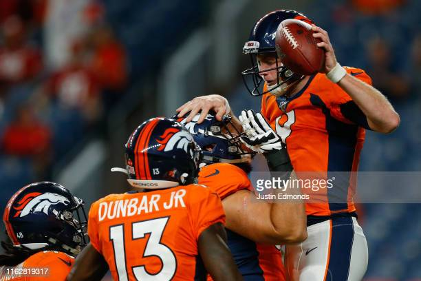 Quarterback Kevin Hogan of the Denver Broncos celebrates his fourth-quarter touchdown with teammates against the San Francisco 49ers in a preseason...