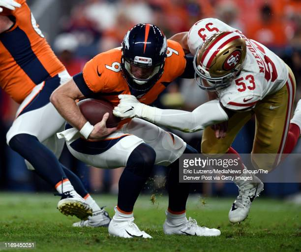 Quarterback Kevin Hogan of the Denver Broncos gets sacked by outside linebacker Mark Nzeocha of the San Francisco 49ers during the third quarter of...