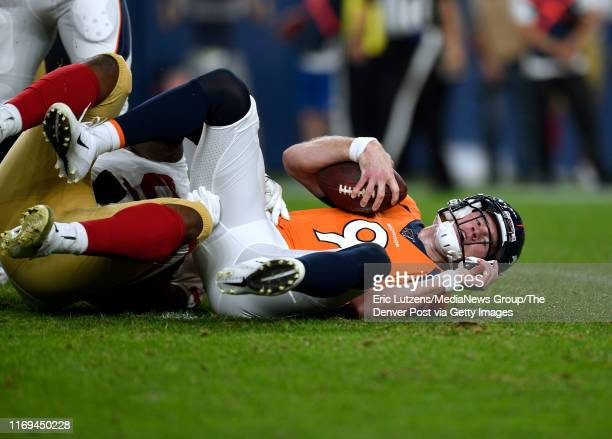 Quarterback Kevin Hogan of the Denver Broncos gets sacked for a loss of 6 by defensive tackle Jay Bromley of the San Francisco 49ers during the...