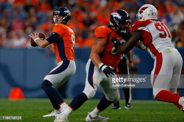 Quarterback Kevin Hogan of the Denver Broncos throws a pass against the Arizona Cardinals during the first quarter of a preseason game at Broncos...