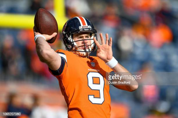Quarterback Kevin Hogan of the Denver Broncos throws as he warms up before a game against the Pittsburgh Steelers at Broncos Stadium at Mile High on...