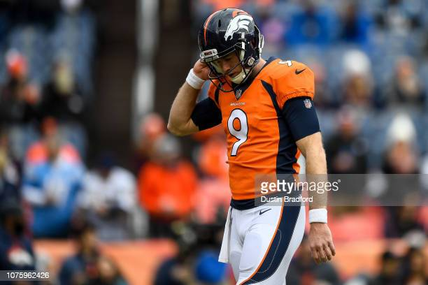 Quarterback Kevin Hogan of the Denver Broncos walks on the field as players warm up before a game against the Los Angeles Chargers at Broncos Stadium...