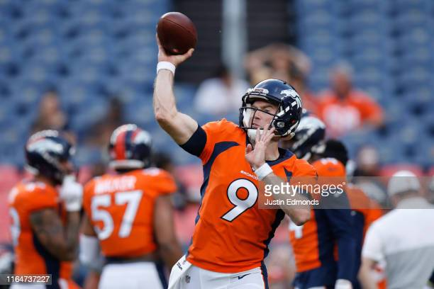 Quarterback Kevin Hogan of the Denver Broncos warms up before a preseason game against the Arizona Cardinals at Broncos Stadium at Mile High on...