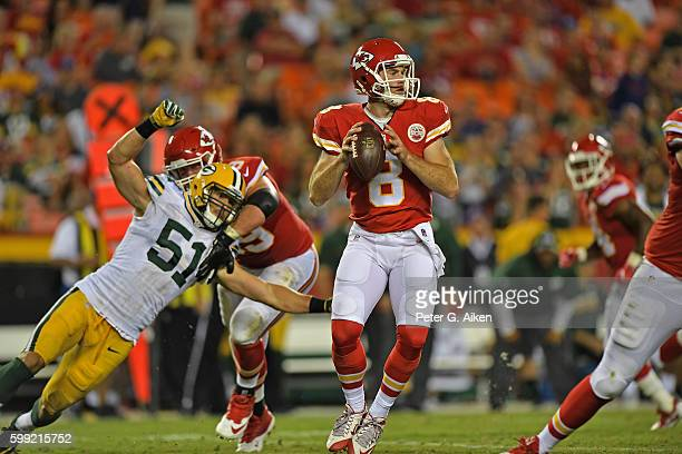Quarterback Kevin Hogan of the Kansas City Chiefs drops back to pass against the Green Bay Packers during the second half on September 1, 2016 at...