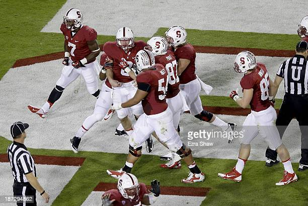 Quarterback Kevin Hogan of the Stanford Cardinal celebrates after an 11yard touchdown run in the second quarter against the Oregon Ducks at Stanford...