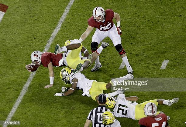 Quarterback Kevin Hogan of the Stanford Cardinal dives into the endzone to score an 11-yard touchdown run in the second quarter against the Oregon...