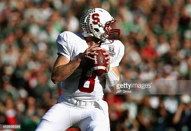 Quarterback Kevin Hogan of the Stanford Cardinal drops back to pass against the Michigan State Spartans in the first quarter of the 100th Rose Bowl...