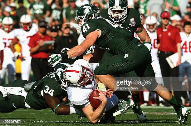 Quarterback Kevin Hogan of the Stanford Cardinal rushes with the ball against the Michigan State Spartans in the first quarter of the 100th Rose Bowl...