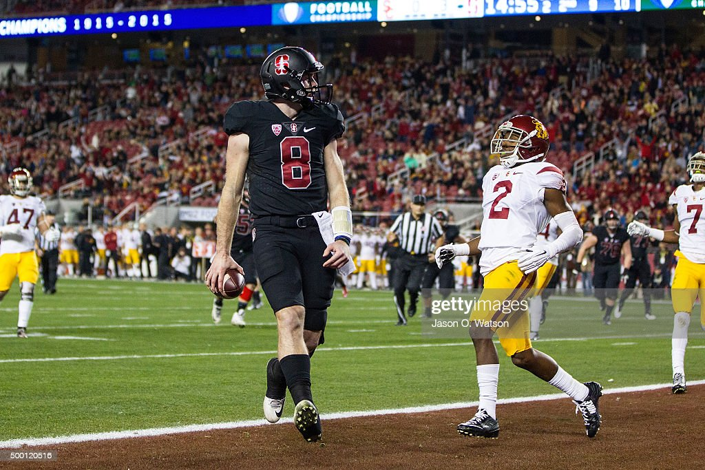 Quarterback Kevin Hogan #8 of the Stanford Cardinal scores a touchdown past cornerback Adoree' Jackson #2 of the USC Trojans during the second quarter of the Pac-12 Championship game at Levi's Stadium on December 5, 2015 in Santa Clara, California.