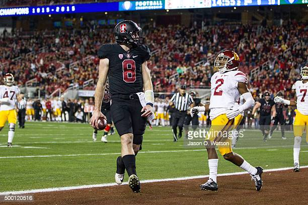 Quarterback Kevin Hogan of the Stanford Cardinal scores a touchdown past cornerback Adoree' Jackson of the USC Trojans during the second quarter of...