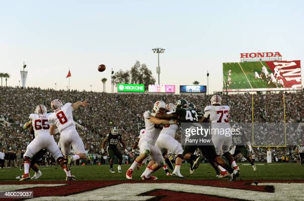 Quarterback Kevin Hogan of the Stanford Cardinal throws a pass from his end zone during the third quarter against the Michigan State Spartans in the...