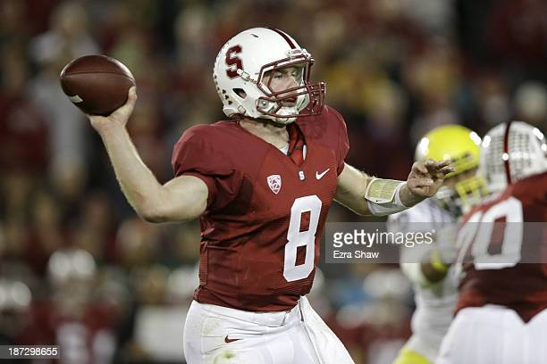 Quarterback Kevin Hogan of the Stanford Cardinal throws the ball in the first half against the Oregon Ducks at Stanford Stadium on November 7 2013 in...