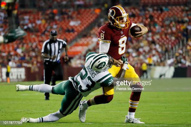 Quarterback Teddy Bridgewater of the New York Jets is sacked by linebacker Jerod Fernandez of the Washington Redskins in the third quarter of a...