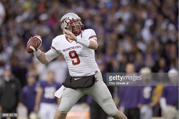Quarterback Kevin Lopina of the Washington State Cougars passes the ball during the game against the Washington Huskies on November 28, 2009 at Husky...