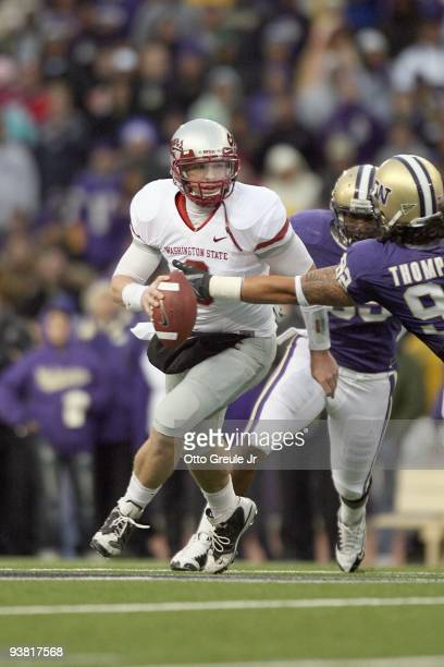 Quarterback Kevin Lopina of the Washington State Cougars runs the ball during the game against the Washington Huskies on November 28, 2009 at Husky...