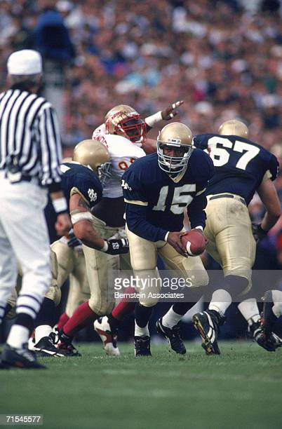 Quarterback Kevin McDougal of the University of Notre Dame Fighting Irish handsoff the ball against the Florida State University Seminoles during the...