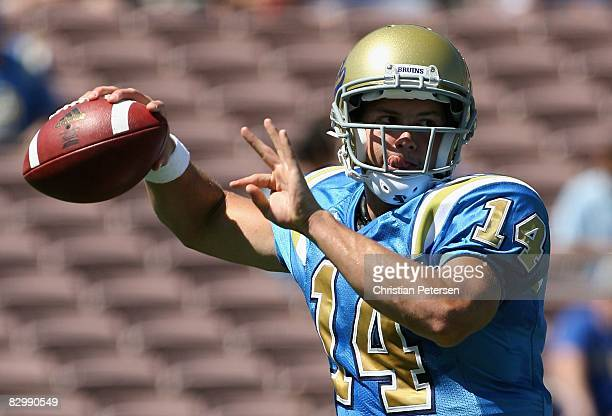 Quarterback Kevin Prince of the UCLA Bruins warms up before the college football game against the Arizona Wildcats at the Rose Bowl on September 13...