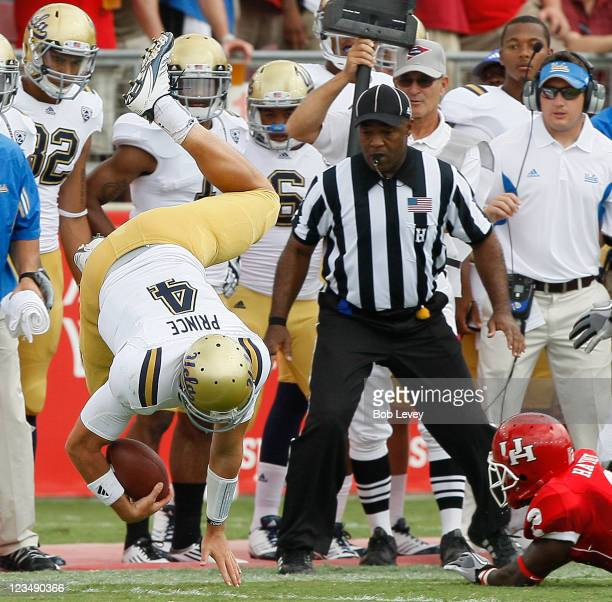 Quarterback Kevin Prince of UCLA is knocked out of bounds by defensive back DJ Hayden of the Houston Cougars at Robertson Stadium on September 3 2011...