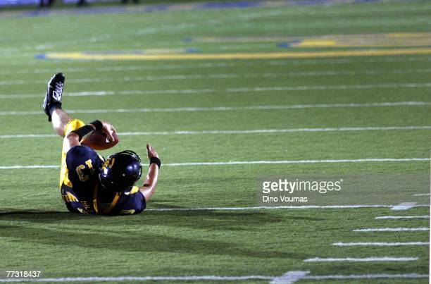 Quarterback Kevin Riley of the California Golden Bears hits the turf tackled on the last play of the game as time runs out in a college football game...