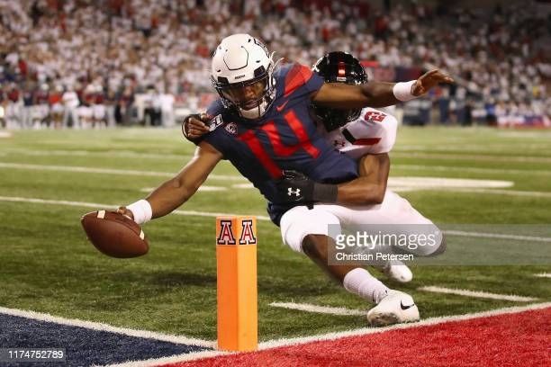 Quarterback Khalil Tate of the Arizona Wildcats comes up short of the endzone as he rushes the football tackled by cornerback Ja'Marcus Ingram of the...