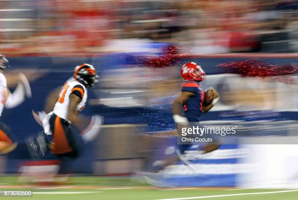 Quarterback Khalil Tate of the Arizona Wildcats runs for a 71yard touchdown during the third quarter half of the college football game against the...