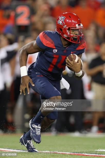 Quarterback Khalil Tate of the Arizona Wildcats scrambles with the football during the second half of the college football game against the Oregon...