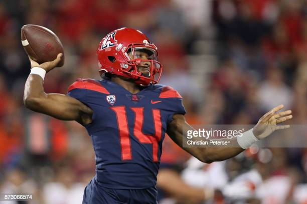 Quarterback Khalil Tate of the Arizona Wildcats throws a pass during the first half of the college football game against the Oregon State Beavers at...