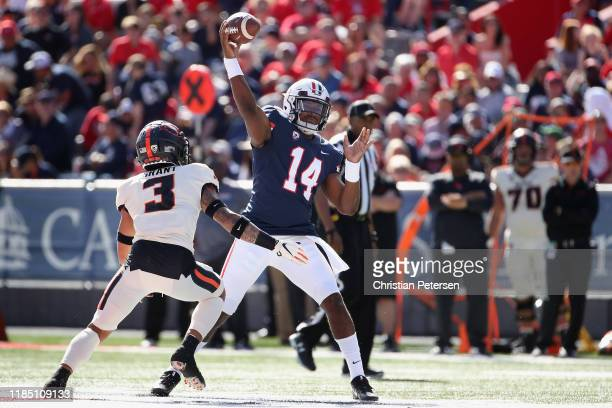 Quarterback Khalil Tate of the Arizona Wildcats throws a pass over defensive back Jaydon Grant of the Oregon State Beavers during the first half of...