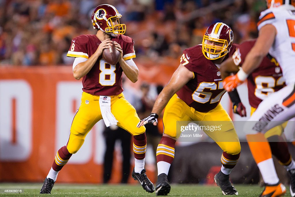 Quarterback Kirk Cousins #8 looks for a pass with protection from guard Josh LeRibeus #67 of the Washington Redskins during the first half against the Cleveland Browns at FirstEnergy Stadium on August 13, 2015 in Cleveland, Ohio.