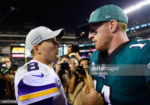 Quarterback Kirk Cousins of the Minnesota Vikings and quarterback Carson Wentz of the Philadelphia Eagles shake hands after the Vikings 2321 win at...