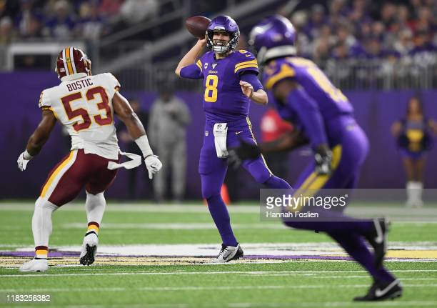 Quarterback Kirk Cousins of the Minnesota Vikings looks to deliver a pass against the defense of Jon Bostic of the Washington Redskins during the...