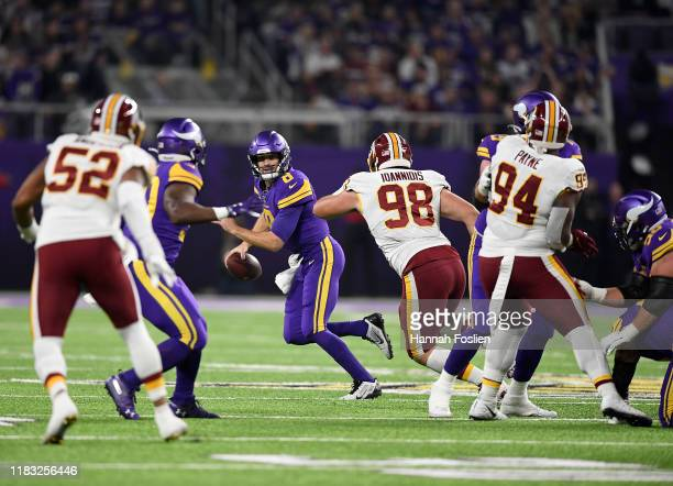 Quarterback Kirk Cousins of the Minnesota Vikings looks to deliver a pass against the defense of Matthew Ioannidis of the Washington Redskins during...