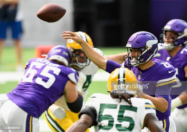 Quarterback Kirk Cousins of the Minnesota Vikings passes the ball against the Green Bay Packers during the first quarter of the game at U.S. Bank...