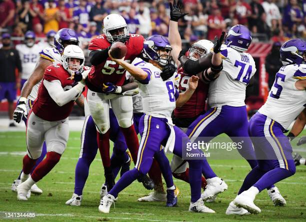 Quarterback Kirk Cousins of the Minnesota Vikings passes under pressure from Chandler Jones of the Arizona Cardinals in the second half of the game...