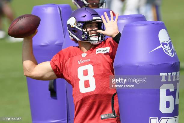 Quarterback Kirk Cousins of the Minnesota Vikings runs a drill during training camp on August 21, 2020 at TCO Performance Center in Eagan, Minnesota.