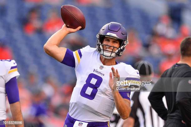 Quarterback Kirk Cousins of the Minnesota Vikings throws as he warms up before an NFL preseason game against the Denver Broncos at Broncos Stadium at...
