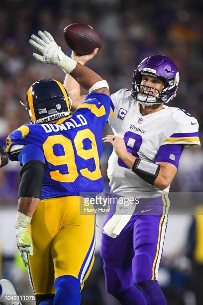 Quarterback Kirk Cousins of the Minnesota Vikings throws by defensive tackle Aaron Donald of the Los Angeles Rams in the second quarter at Los...
