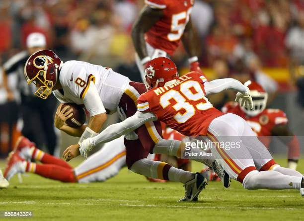 Quarterback Kirk Cousins of the Washington Redskins carries the ball as cornerback Jacoby Glenn of the Kansas City Chiefs defends during the game at...