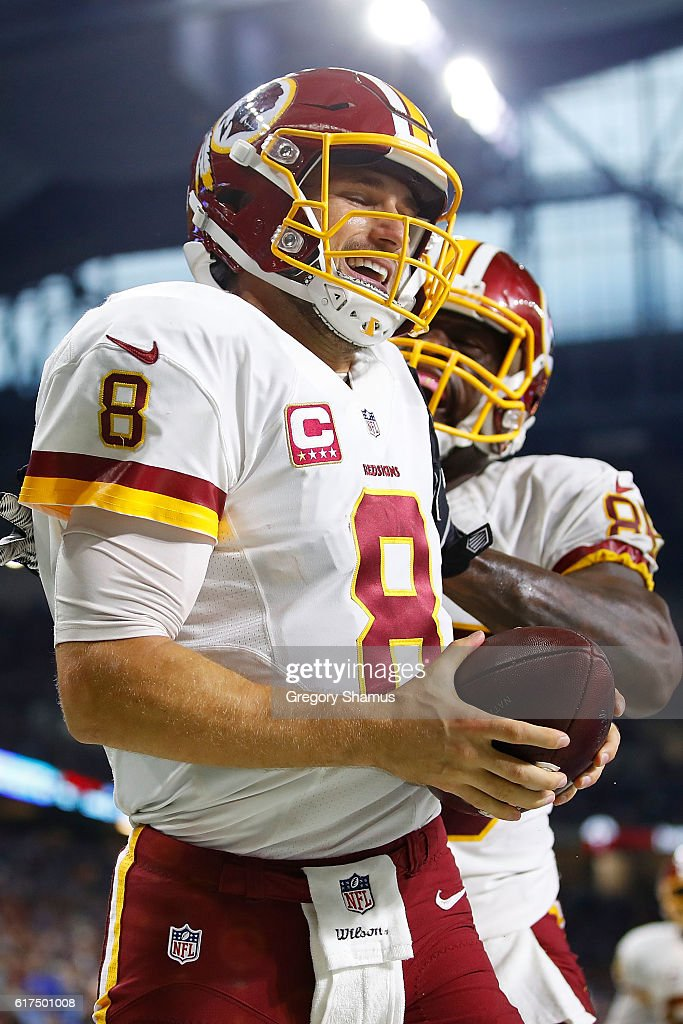 Quarterback Kirk Cousins #8 of the Washington Redskins celebrates his touchdown with Vernon Davis #85 during fourth quarter action against the Detroit Lions at Ford Field on October 23, 2016 in Detroit, Michigan