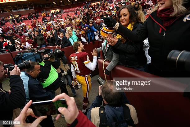 Quarterback Kirk Cousins of the Washington Redskins celebrates with fans after the Washington Redskins defeated the Buffalo Bills 3525 at FedExField...