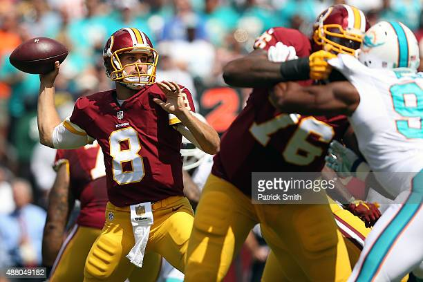 Quarterback Kirk Cousins of the Washington Redskins drops back in the first half during a game against the Miami Dolphins at FedExField on September...