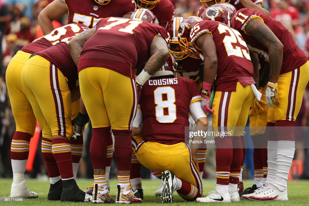 Quarterback Kirk Cousins #8 of the Washington Redskins huddles up with his offense against the San Francisco 49ers during the first half at FedExField on October 15, 2017 in Landover, Maryland.