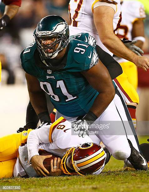 Quarterback Kirk Cousins of the Washington Redskins is sacked by Fletcher Cox of the Philadelphia Eagles in the second quarter of a football game at...