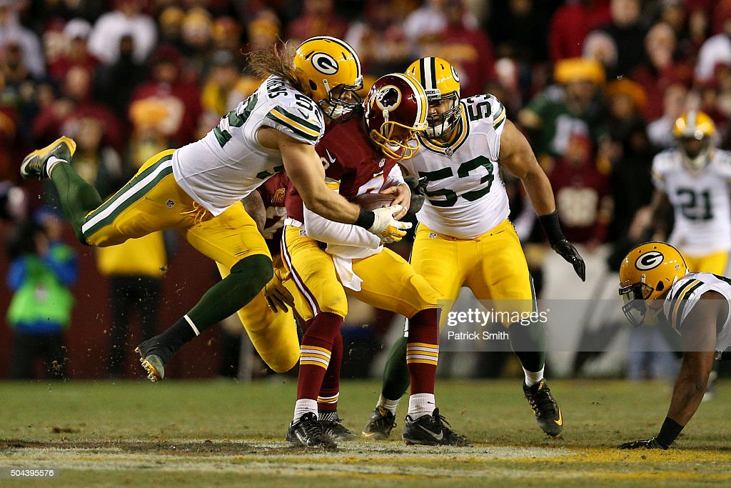 Quarterback Kirk Cousins #8 of the Washington Redskins is sacked by inside linebacker Clay Matthews #52 of the Green Bay Packers in the fourth quarter during the NFC Wild Card Playoff game at FedExField on January 10, 2016 in Landover, Maryland.