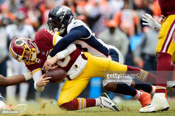 Quarterback Kirk Cousins of the Washington Redskins is sacked by outside linebacker Von Miller of the Denver Broncos in the second quarter at...