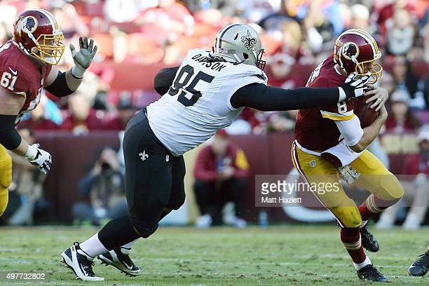 Quarterback Kirk Cousins of the Washington Redskins is tackled by defensive tackle Tyeler Davison of the New Orleans Saints in the second quarter at...