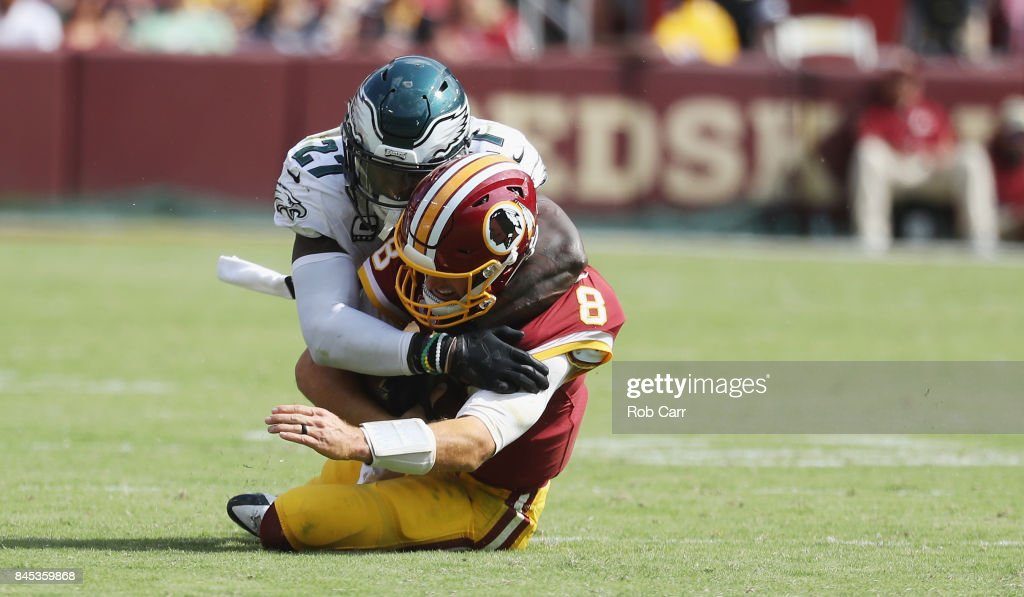 Quarterback Kirk Cousins #8 of the Washington Redskins is tackled by Malcolm Jenkins #27 of the Philadelphia Eagles in the third quarter at FedExField on September 10, 2017 in Landover, Maryland.