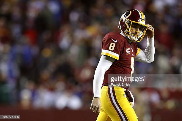 Quarterback Kirk Cousins of the Washington Redskins looks on against the New York Giants in the third quarter at FedExField on January 1 2017 in...